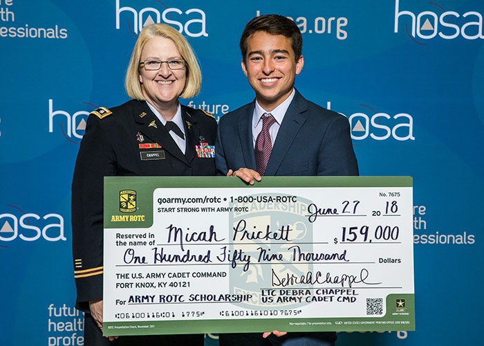 Scholarship Recipient Holding Check